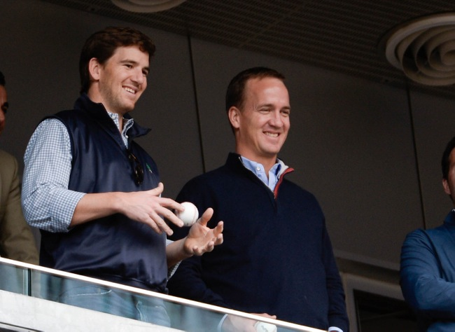 Eli and Peyton Manning (May 4, 2014)