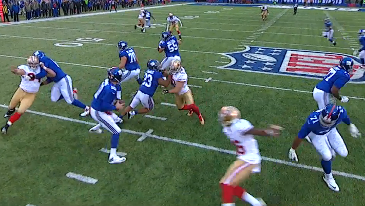 Pocket collapsing on Manning as he rushes his throw