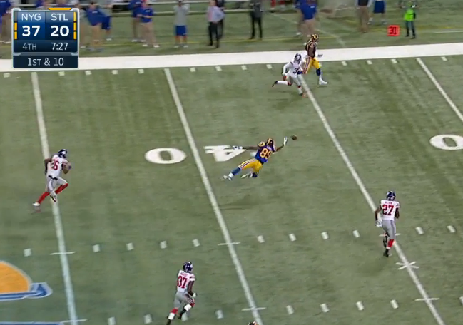 Tight end wide open deep down middle but Hill overthrows him.