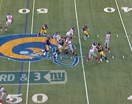 Here Eli makes pass protection look better than it was as he throws off back foot for 23-yard gain.