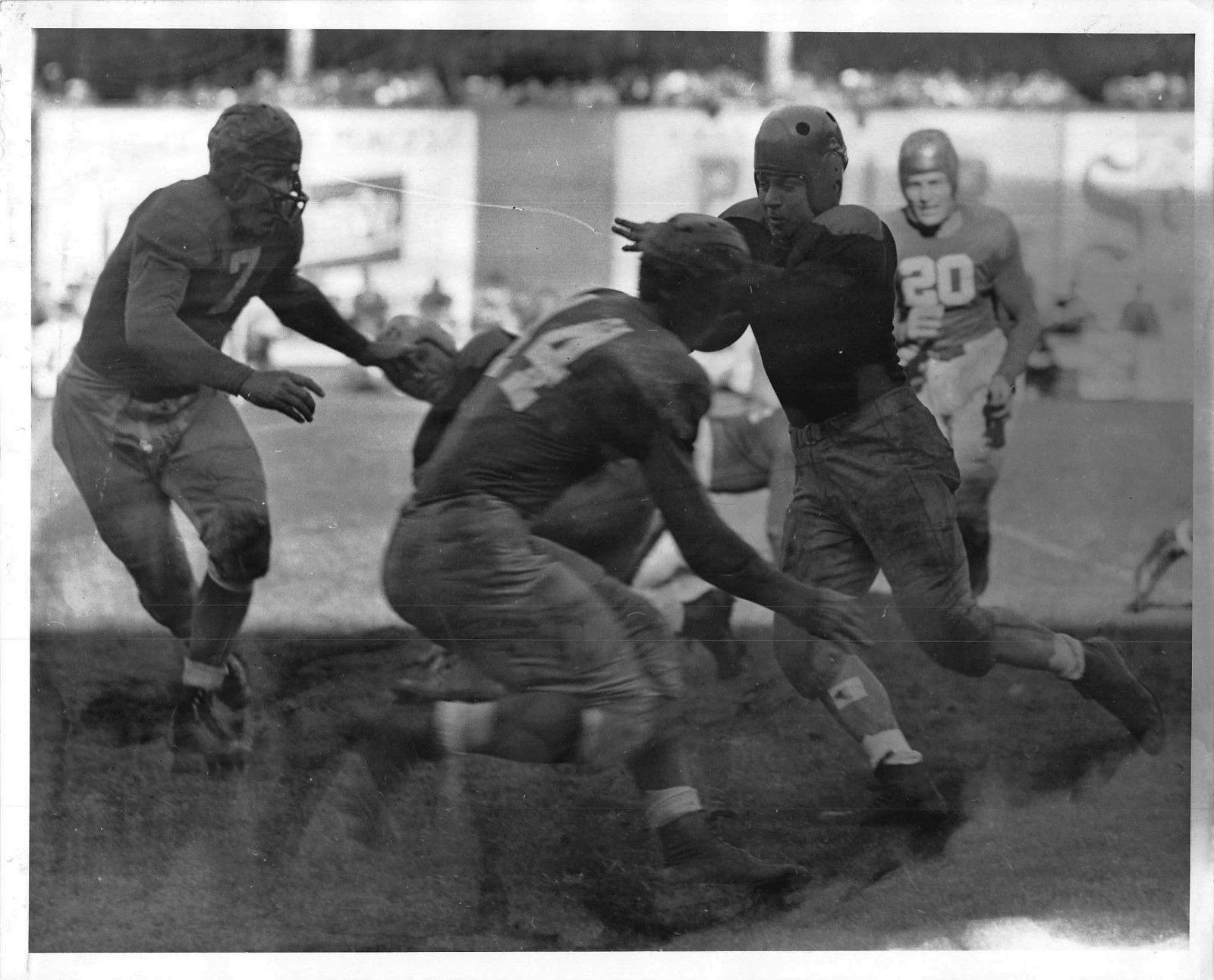 Mel Hein (7), Ward Cuff (14), and Leland Shaffer (20); New York Giants (October 31, 1943)