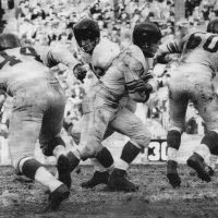 Charlie Conelry handing off to Eddie Price, Kyle Rote running behind, Philadelphia Eagles at New York Giants (November 14, 1954)