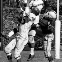 Emlen Tunnell foreground (no facemask), Dick Nolan (lucite facemask), New York Giants at Pittsburgh Steelers (October 9, 1955)