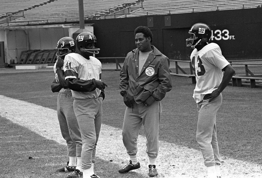 "Joe Green (#33), Willie Williams (#41), Coach Emlen Tunnell, Carl ""Spider"" Lockhart (#43) at practice in 1971"