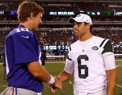 Eli Manning and Mark Sanchez – © USA TODAY Sports Images