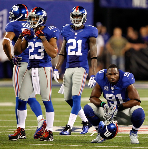 Corey Webster (23), Kenny Phillips (21), Justin Tuck (91), New York Giants (September 5, 2012)