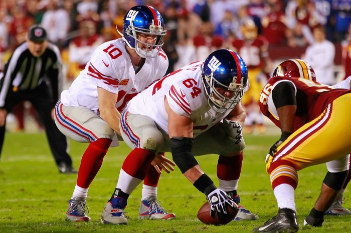Eli Manning and David Baas – © USA TODAY Sports Images