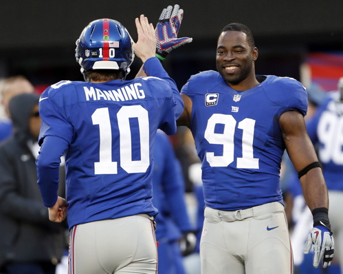 Eli Manning (10), Justin Tuck (91), New York Giants (December 30, 2012)