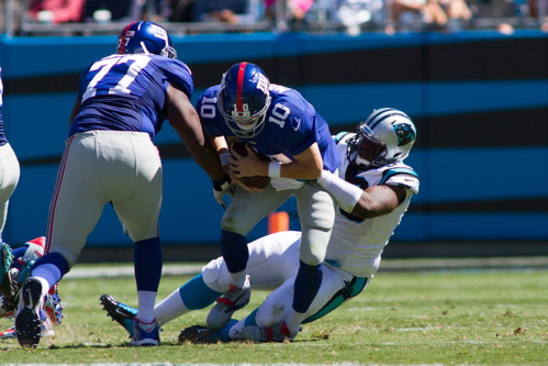 Kevin Boothe (77) and Eli Manning, New York Giants (September 22, 2013)