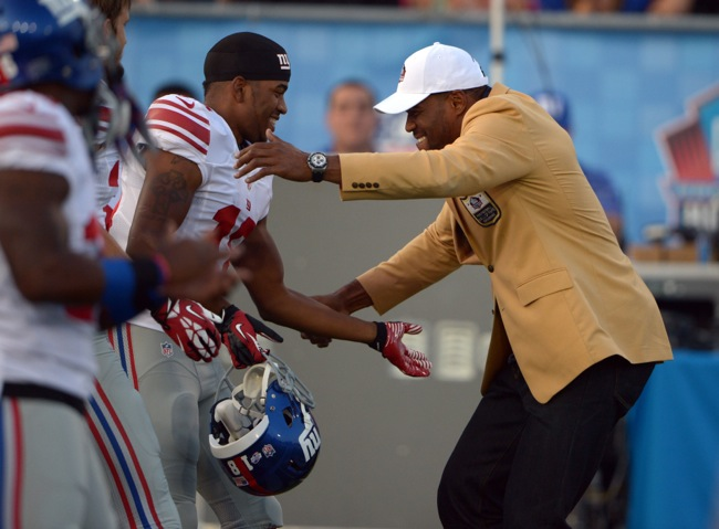 Marcus Harris and Michael Strahan – © USA TODAY Sports Images