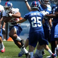 Rashad Jennings (23) and Kyle Sebetic (25), New York Giants (June 18, 2014)