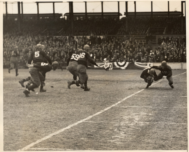 Red Badgro (17), New York Giants makes tackle for a safety against Notre Dame All-Stars (December 14, 1930)