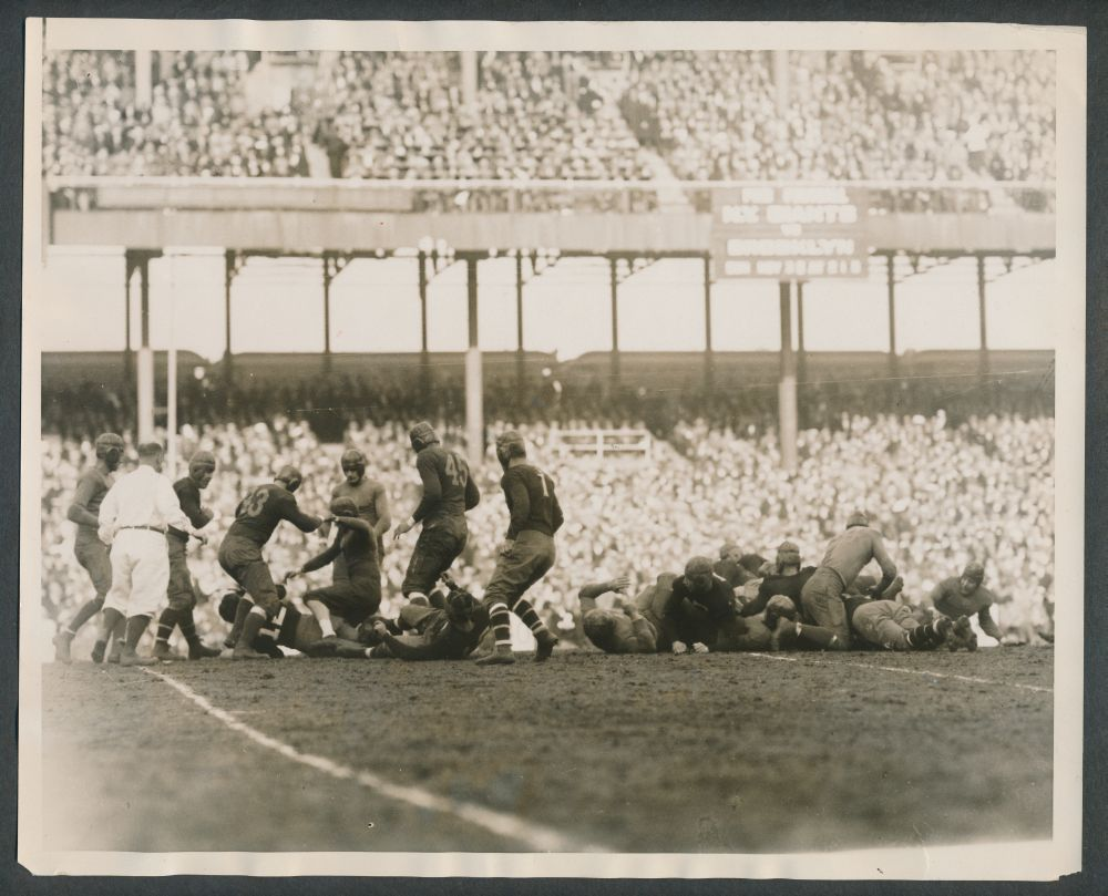 Chris Cagle (12), Benny Friedman (1), New York Giants; Green Bay Packers at New York Giants (November 23, 1930)