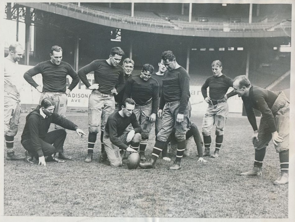 Joe Williams (standing white shirt), Coach Bob Folwell (kneeling), Century Milstead (standing), Art Carney, Hinkey Haines (setting the ball), Dutch Hendrian (standing in rear, obscured), Heinie Benkert (over Haines), Jack McBride (in rear, obscured), Jim Thorpe (kicking), Paul Jappe, Lynn Bomar (hands on knees); New York Giants (1925)