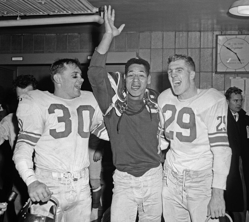 Bill Svoboda (30), Emlen Tunnell (middle), Alex Webster (29); New York Giants, (December 30, 1956)