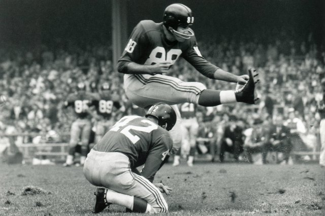 Charlie Conerly (42) and Pat Summerall (88)