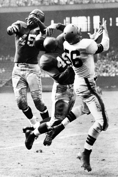Emlen Tunnell (45), Tom Landry (49); New York Giants at Cleveland Browns (October 1, 1950)